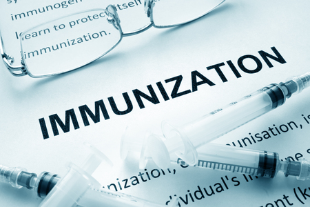 Paper with word immunization and glasses.