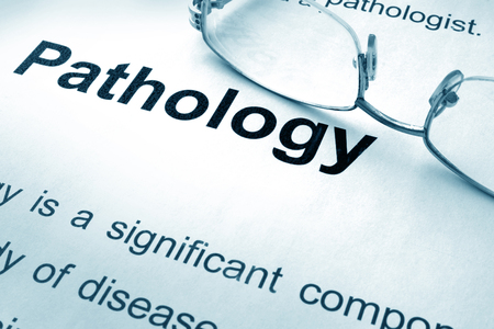 pathology: Pathology written on a paper. Medical concept.