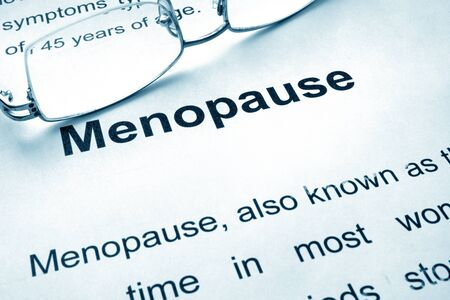hormonal: Menopause written on a paper. Medical concept. Stock Photo