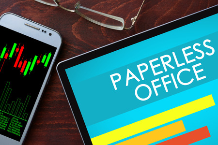 Paperless office written on a tablet. Business concept.