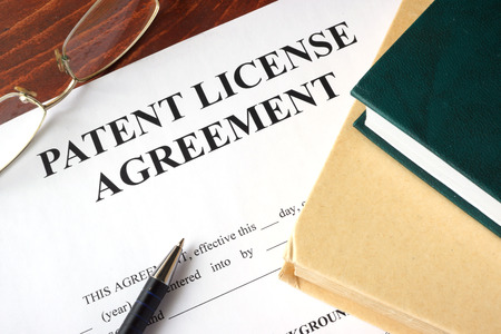 Patent License agreement on a table. Copyright concept. Banque d'images