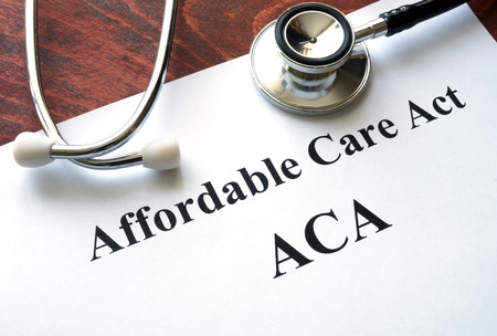 affordable: Words Affordable Care Act  ACA written on a paper.