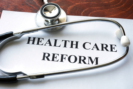 reform: Words healthcare reform written on a paper.