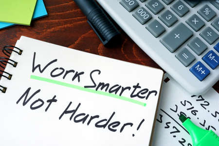 smarter: Notepad with sign Work Smarter Not Harder. Stock Photo