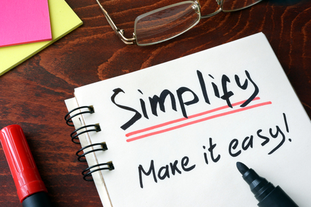 pragmatic: Notepad with sign simplify.  Make it easy. Stock Photo