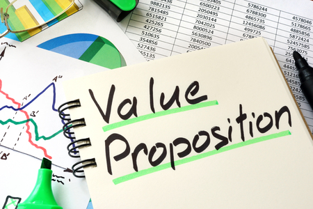 Value Proposition written on a notepad sheet.