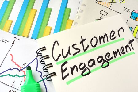 customer: Customer Engagement written on a notepad sheet.
