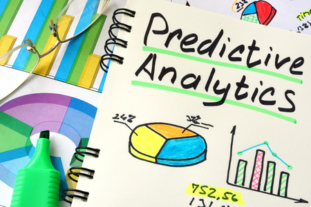 predictive: Predictive Analytics written on a notepad sheet.
