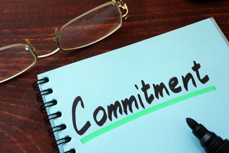 commitment committed: Commitment written on a notepad with marker.