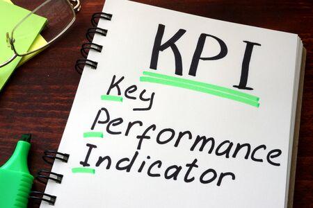 performances: Key Performance Indicators KPI written on a notepad with marker.