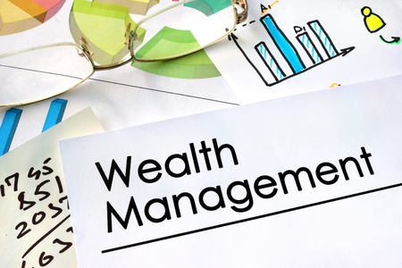 wealth management: Paper with words Wealth Management and charts.