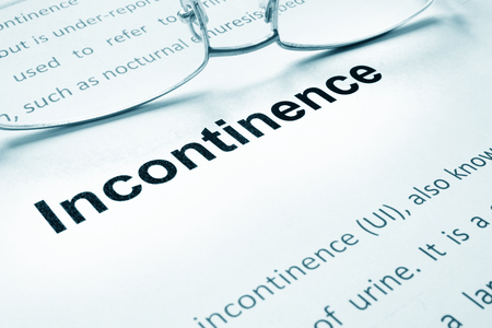 incontinence: Incontinence sign on a paper and glasses.