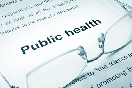 public health: Public health sign on a paper and glasses. Stock Photo