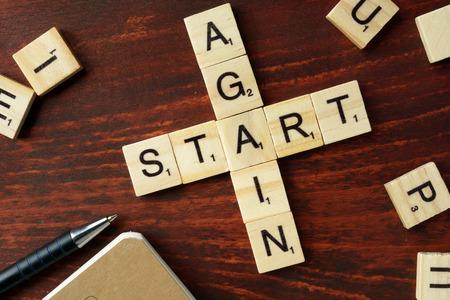 Words Start Again from wooden blocks with letters. Reklamní fotografie