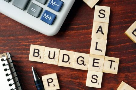 budgets: Words Sales Budget from wooden blocks with letters.