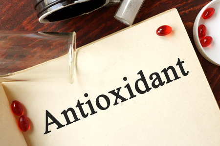 Antioxidant written on a page. Chemistry concept. Stock Photo
