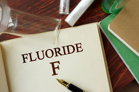 fluoride: Fluoride written on a page. Chemistry concept.