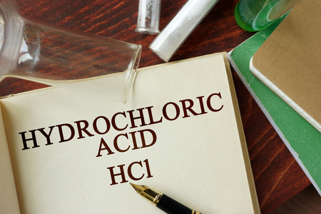 hydrochloric: Words hydrochloric acid written on a page. Chemistry concept.