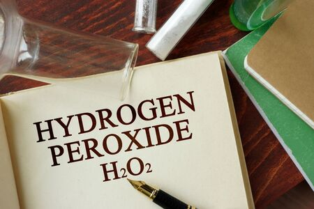 hidr�geno: Words hydrogen peroxide written on a page. Chemistry concept.