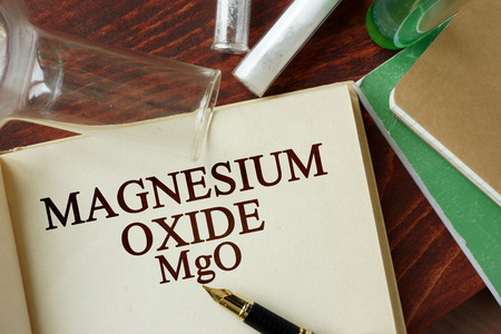 oxide: Word magnesium oxide written on a page. Chemistry concept. Stock Photo