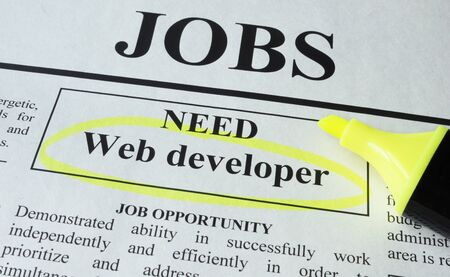 web developer: Newspaper with ads for vacancy Web developer. Employment concept.