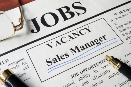 sales manager: Newspaper with ads for vacancy sales manager. Employment concept.