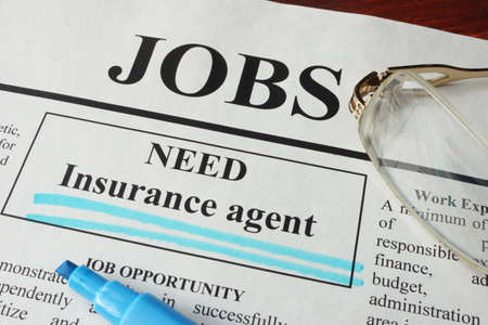 vacancy: Newspaper with ads for vacancy Insurance agent. Employment concept. Stock Photo