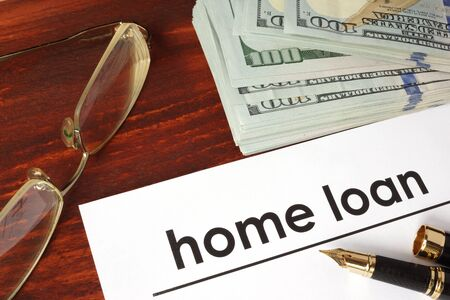 business loans: Paper with words home loan on a wooden background. Stock Photo