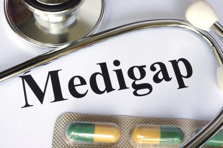 medicaid: Medigap written on a paper. Medical concept.