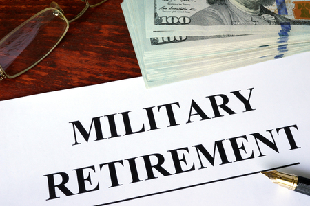 transition: Military retirement written on a paper. Financial concept.