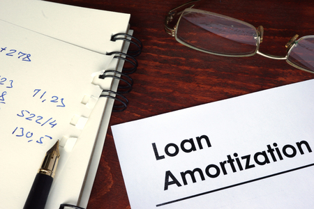 amortization: Loan amortization written on a paper. Financial concept.