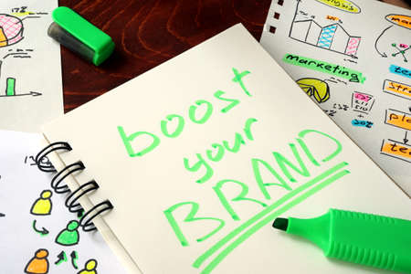 your: Sign boost your brand in a notebook.