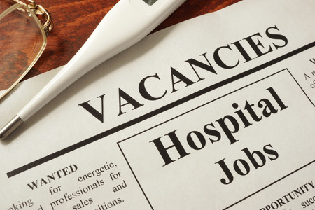 Newspaper with ads hospital jobs vacancy.