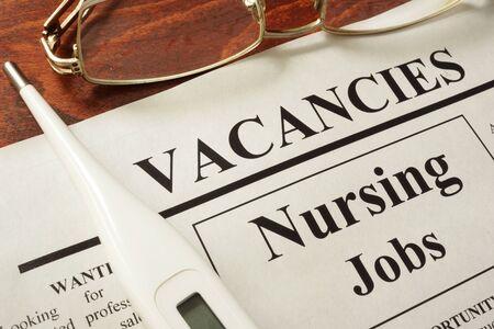Newspaper with ads nursing jobs vacancy.
