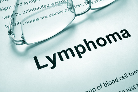 lymphoma: Paper with word lymphoma and glasses. Stock Photo