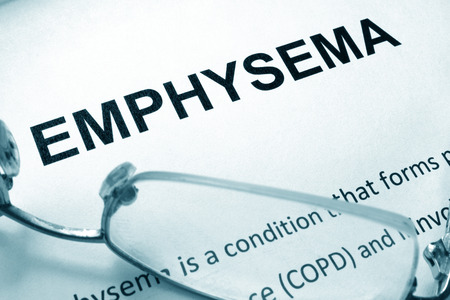Paper with word  emphysema and glasses.