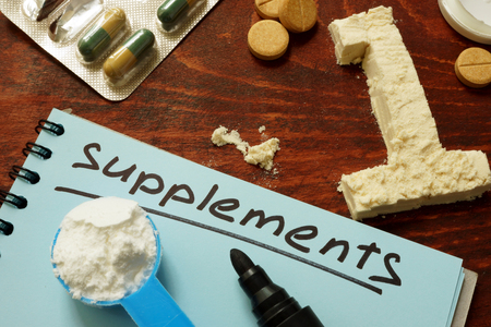 casein: Notebook with  sign supplements and number one from protein.