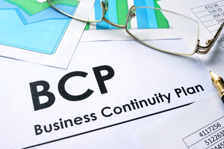 bcp: Paper with words BCP Business Continuity Plan Stock Photo