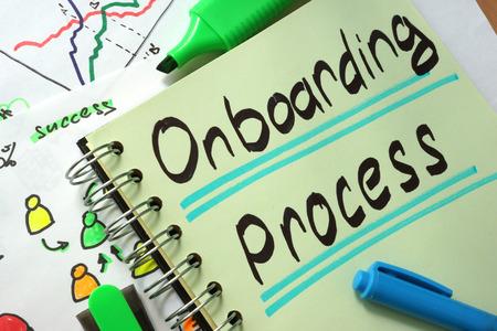 Notebook met teken Onboarding Process en grafieken.