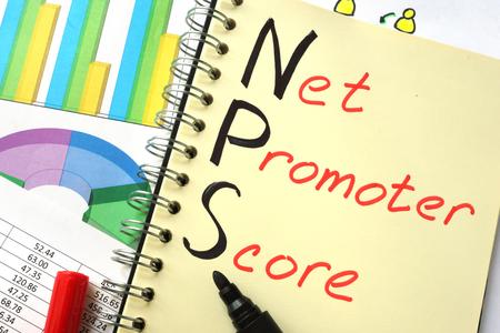 Notebook with  sign NPS net promoter score Standard-Bild