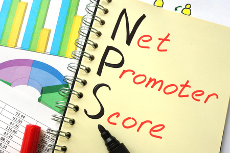 Notebook with  sign NPS net promoter score Фото со стока