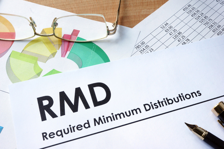 Paper with words RMD required minimum distributions Stockfoto