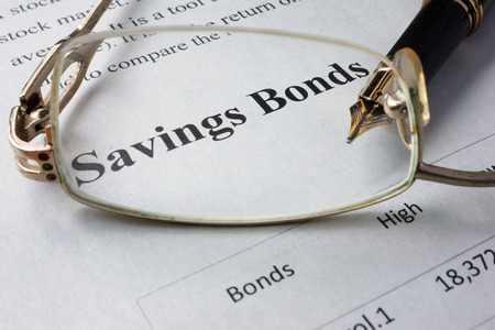 bonds: Page of newspaper with words savings bonds. Trading concept. Stock Photo