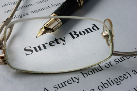 surety: Page of newspaper with words surety bond. Stock Photo