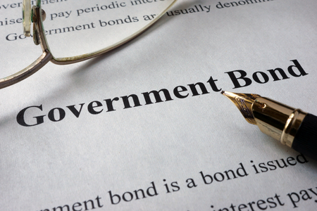 Page of newspaper with words government bonds. Trading concept. Standard-Bild