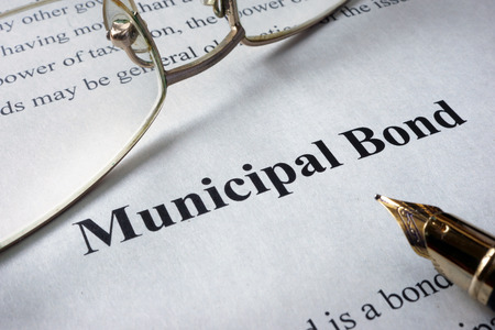 Page of newspaper with words municipal bonds. Trading concept. Stock Photo