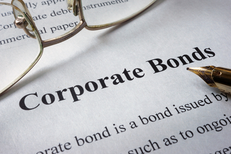 Page of newspaper with words corporate bonds. Trading concept.