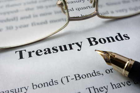 treasury: Page of newspaper with words treasury bonds. Trading concept.