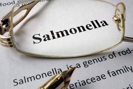 salmonella: Page of book with diagnosis Salmonella and glasses. Stock Photo