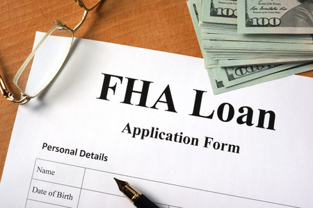FHA loan form on a wooden table.